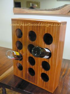 Wall mounted Mahogany wine rack made for 12 bottles.
