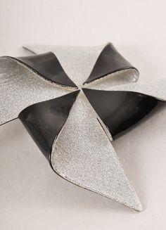 Lea Stein Black and Silver Toned Acetate Metallic Pin Wheel Brooch Detail