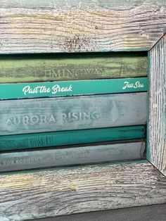 Paint Books and Frame them for a cute and functional shelf decoration