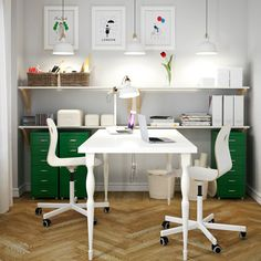 A white home office with white LINNMON table for two, VÅGSBERG/SPORREN swivel chairs in white and HELMER drawer units in green.