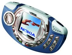 Nokia 3300 My second phone . First phone to have MP3 player. with big old SD card 256mb. i could fit in about 20 songs.