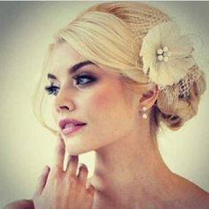 Wedding hair up do- like the flower w/ piece of veil on the side