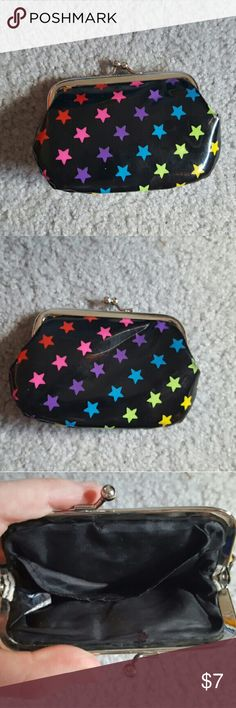 Mini rainbow star coin purse This mini coin purse features rainbow colored stars and a black backround. The inside of the coin purse features one small pocket along the side. The clasp works perfectly and the coin purse is in good condition. Bags Cosmetic Bags & Cases