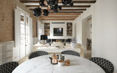 Apartment Renovation Brings Contemporary Style to Medieval Barcelona