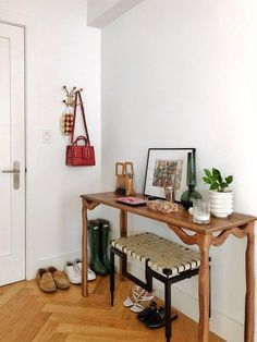 Apartment entryway table with leather bench.