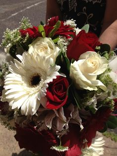 Bridal bouquet, white gerber daisies, red and white roses, white orchids