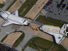 NASA's space shuttles Endeavour and Atlantis switched locations today at Kennedy Space Center in Florida, and in the process came