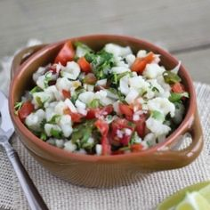 A vegan ceviche recipe with lime juice-marinated cauliflower, onions, tomatoes, roasted poblano peppers and cilantro.