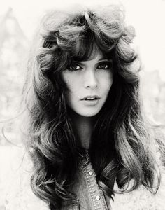 70s, wow she is beautiful and love this hair