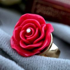Red Rosette Ring Gorgeous Red Rosette Ring  Size: 6  Materials: Gold Plated Base Metals, Resin, Rhinestone  Nickel & Lead Free  Condition: New Jewelry Rings