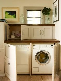 Hidden laundry cabinet. Perfect for moving laundry to main living level.
