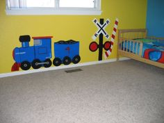 Toddler boy train theme. Hand painted train mural and railroad crossing sign.