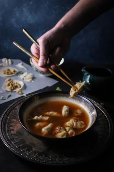 Crispy pan fried chicken dumplings cradled in a deliciously spicy chili broth. Perfect on cold Winter nights replete with Asian food cravings!