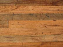 Reclaimed hardwood flooring.  So sweet.