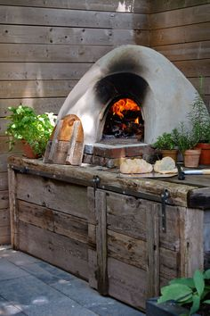 Cob-oven-1 For pizza and bread in the backyard from the Art of Doing Stuff.