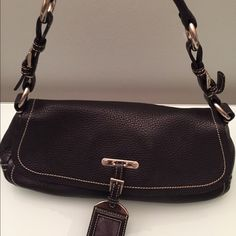 Prada handbag. 100% authentic. Preloved No dust bag or receipt. I purchased from Neiman few years ago. I carry big bags so this is too small for me. Beautiful pebbled leather and excellent condition.I only used it handful of times. Prada Bags Shoulder Bags