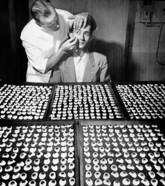 Movable eye, 1948. From trays of assorted eyes codesigner Fritz Jardon of american optical company finds a match for patient's good right eye.