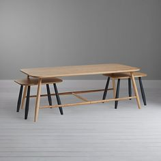 Ingeniously distinct, this coffee table and pair of nest of tables are beautifully hand-crafted in English Ash, which is sourced from renewable woodlands and carefully selected for perfect grain match.
