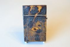 A pressed Tortoiseshell card case with Pugin designed windows in good condition and colour. C1870