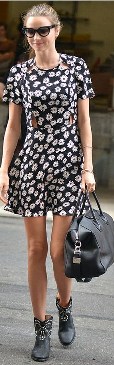 Who made Miranda Kerr's black handbag, blue cut out floral dress, and black studded boots? Dress – Topshop Shoes – Isabel Marant Purse – Givenchy
