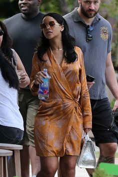 3/14/16 Rihanna was spotted in Miami wearing a Dries Van Noten dress and a Dior tote