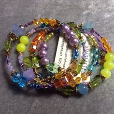 Four-loop glass beaded memory wire bracelet, bright rainbow colors, one size fits all, fair trade, summer, beach, gift, free shipping.