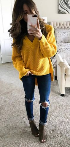 Love this bright yellow cozy sweater. how to wear ripped jeans : yellow sweater and boots