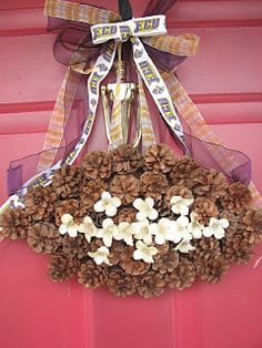 how cute!!!  football wreath made with pinecones!  *love*  :)