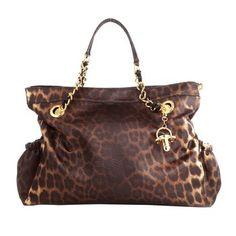 Leopard Diaper Bag and Pad. Maybe we should call this diaper bag a convertible tote. While surely practical, all you have to do is remove the detachable pacifier charm and this utilitarian baby bag transforms into a chic statement piece. $375.00