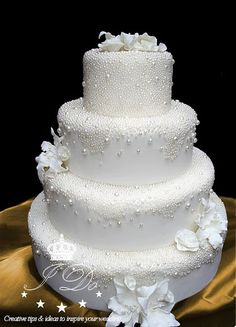 a white wedding cake with sugar pearls attached is ideal for a winter wonderland wedding Sparkly Wedding Cakes, Christmas Wedding Cakes, Big Wedding Cakes, Wedding Cake Photos, Floral Wedding Cakes, Wedding Cakes With Cupcakes, Elegant Wedding Cakes, Beautiful Wedding Cakes, Wedding Cake Designs