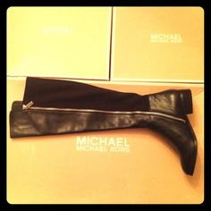 NEW MICHAEL KORS BLACK KNEE HIGH BOOTS NEW, knee high, stretchy black boots with silver zipper. Front leather, back stretch material. Cap of box slightly damaged, but shoes are fully packaged and new. Michael Kors Shoes Over the Knee Boots