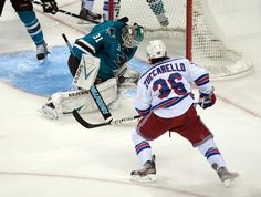 San Jose Sharks goaltender Antti Niemi makes a save on New York Rangers forward Mats Zuccarello during the second period (Oct. 8, 2013).