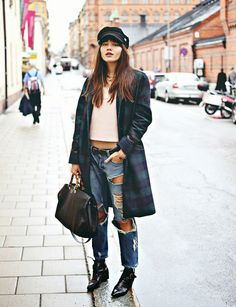 Natalie Suarez of Natalie Off Duty rocks out in destroyed boyfriend jeans and a plaid coat.