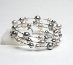 I am always a sucker for beautiful silver jewelry! Large Wrist Floating Pearl Memory Wire Bracelet - Swarovski Pearl Bracelet in White and Silver Gray - Plus Size Bracelet - Handmade Jewelry Memory Wire Jewelry, Memory Wire Bracelets, Handmade Bracelets, Jewelry Bracelets, Pearl Bracelets, Memory Wire Rings, Diamond Bracelets, Pearl Jewelry, Beaded Jewelry