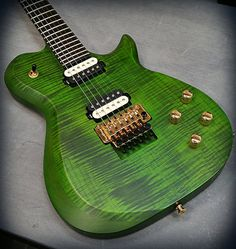 Kiesel Guitars Carvin Guitars  SCB6 in deep moss green over flamed maple top