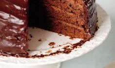 A gâteau for a special occasion: four layers of cake with truffle filling and silky chocolate icing.