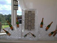 A fantastic champagne bottle ice sculpture wedding seating plan./unusual-ideas-for-wedding-seating-plans Wedding Sitting Plan, Seating Plan Wedding, Frozen Wedding Theme, Frozen Theme, Wedding Table Themes, Wedding Decorations, Wedding Ideas, Wedding Stuff, Table Seating