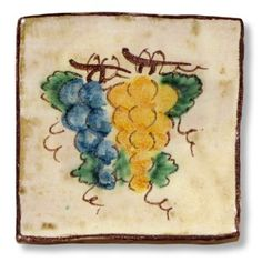 <h3>This Sicilian tile depicts lovely grapes.</h3><br /> <p>The tile is entirely handmade and hand painted in Caltagirone by Giacomo Alessi, one of the most relevant ceramic artists in Italy. <br />Gracefully hand painted with traditional Sicilian subjects, the tiles made by Giacomo Alessi have that particular, witty simplicity that is quintessentially Sicilian. For his Collection 1800 Alessi draws inspiration from the subjects of the pottery made in Caltagirone in the 19th century.</p>
