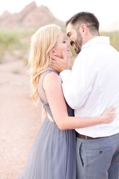 Gorgeous stormy skies, paired with her periwinkle chiffon dress, made this desert engagement one to remember!
