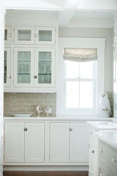 Kitchen walls are Benjamin Moore Edgecomb Gray HC-173.....I think this photo has convinced me to do a light colored glass subway tile- so pretty!