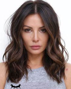 Choose a straight middle parting to add structure to a bob cut of tousled waves #bobcut #wavyhair