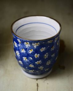 My brother @minstreldead bought me this pretty #porcelain #cup which I of course don't use for fear that I might break it or something.  #tea #blue #flowers #chinaware #nikon #nikkor #50mm #photography
