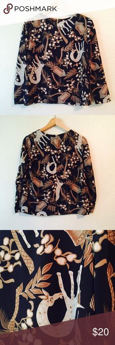 Handmade vintage giraffe floral print shirt XS Gorgeous handmade vintage shirt. Lovely giraffe and floral print wth neutral tones. Very well made and in excellent condition. One of a kind! No size tag, but fits XS, sizes 0 / 2 perfectly. Work appropriate or great for casual wear. Vintage Tops Blouses