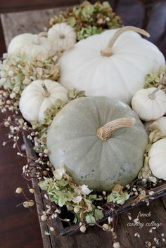 Stunning fall centerpiece with muted colors ... the warm feeling of fall comes through with these subtle colors.