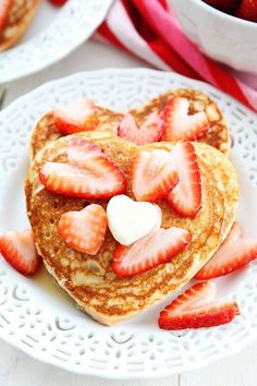 Heart Pancakes Recipe on http://twopeasandtheirpod.com These simple and healthy whole wheat heart shaped pancakes are perfect for Valentine's Day!