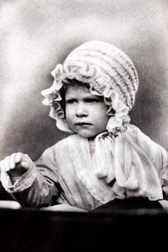 Circa 1927, HRH Princess Elizabeth (Queen Elizabeth II) wearing a cute bonnet