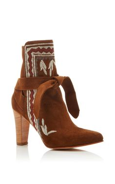 This boot by **Ulla Johnson** is rendered in brown suede, and features…