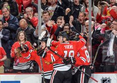The Captain celebrates Shaws goal with Teuvo Teravainen during his first game with the Hawks 3-27-14 please follow me,thank you i will refollow you later