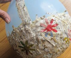 Could be done with recycled magazine paper too. (This site has other Easter and spring ideas for kids as well).