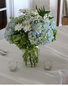 Simple white and blue wedding table arrangement photos Something like this would be pretty in a white pumpkin for a Cinderella theme